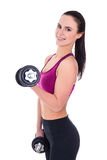 Slim woman in sports wear with dumbbells isolated on white Stock Images