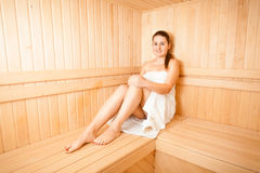 Slim woman steaming at sauna Royalty Free Stock Image