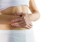 Slim woman touching her belly Stock Photos