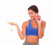 Slim woman in training clothes dieting Royalty Free Stock Image