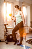 Slim woman training with dumbbells a fitness club Royalty Free Stock Image