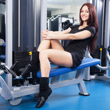 Slim woman training in a gym Stock Images