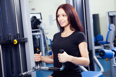 Slim woman training in a gym Stock Photo