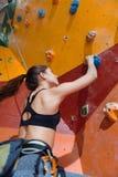 Slim woman training hard in climbing gym Stock Photography