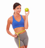 Slim woman in training outfit losing weight Royalty Free Stock Photo