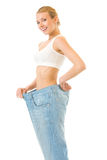 Slim woman trying on old jeans Stock Photo