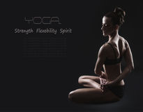 Slim woman in twisted yoga pose Stock Image