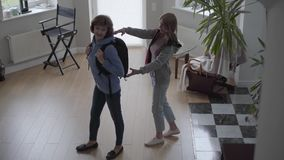 Slim woman walk inside beautiful house with comfortable backpack at the back and blond beautiful woman meet her with big. Slim happy woman walk inside beautiful stock video footage