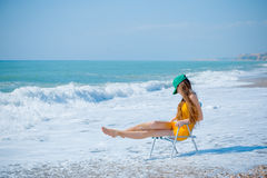 Slim woman in waves Royalty Free Stock Image