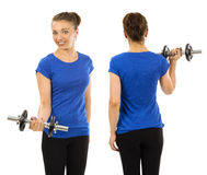 Slim woman wearing blank blue shirt and exercising Royalty Free Stock Image