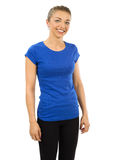 Slim woman wearing blank blue shirt. Photo of a woman posing with a blank blue t-shirt, ready for your artwork or design Stock Photo
