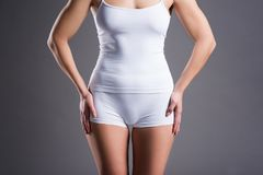 Slim woman in white underwear on gray studio background Royalty Free Stock Photo