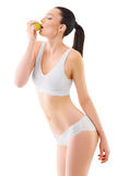 Slim woman in white underwear with green apple at Royalty Free Stock Image