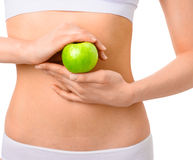 Slim woman in white underwear with green apple at Royalty Free Stock Photos
