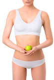Slim woman in white underwear with green apple at Royalty Free Stock Images
