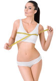 Slim woman in white underwear  and measure around Royalty Free Stock Image
