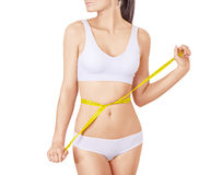 Slim woman in white underwear and measure around Royalty Free Stock Photography