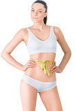 Slim woman in white underwear  and measure around Royalty Free Stock Photo