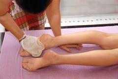 Slim woman having massage. Slim women having massage in hammam Stock Image