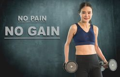 Slim work out woman with dumbbell for no pain no gain. Concept Stock Photography