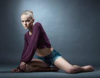Slim young girl posing in fashionable clothes Stock Images