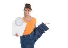 Slim young girl presenting new product for diet. Slim young girl presenting new product for diet isolated over white Royalty Free Stock Photography