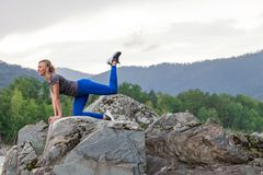 Free Slim Young Sporty Woman Doing The Donkey Kick Exercise On All Fours Arching Back Straightening Leg Up. Concept Sport, Fitness, Royalty Free Stock Images - 159822279