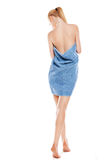 Slim young woman after bath with towel over white Stock Photo