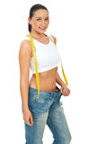 Slim young woman in big jeans royalty free stock photo