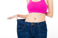 slim young woman with big jeans Royalty Free Stock Photo