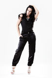 Slim young woman dressed in black trousers Stock Images