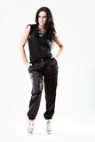 Slim young woman dressed in black trousers. Slim young woman dressed in black with silver heels royalty free stock image