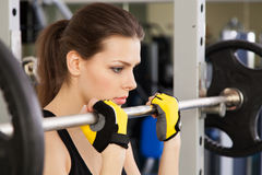 Slim young woman in a gym Royalty Free Stock Photos
