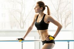 Slim young woman in a gym Royalty Free Stock Images