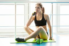 Slim young woman in a gym Stock Photo