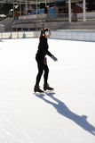Slim Young Woman Ice Skating On An Ice Rink Royalty Free Stock Photos