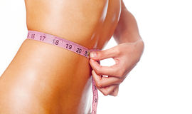 Slim young woman measuring waist. Stock Images