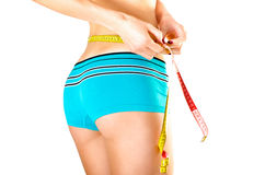 Slim young woman measuring waist Stock Photography
