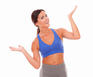 Slim young woman raising both palms with vitality. Slim young woman in sport clothing raising both palms with vitality against white background - copyspace Stock Photos