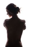 Slim young woman in shadow. Concept for anorexia Stock Photography