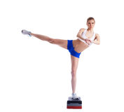 Slim young woman on stepper Stock Images