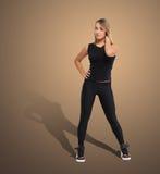 Slim young woman studio portrait Stock Photo