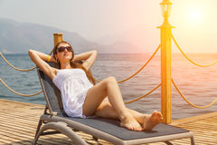 Slim young woman in a white sundress Stock Photography