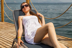 Slim young woman in a white sundress Royalty Free Stock Image