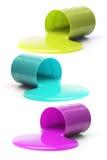 Slime colorido que flui para fora dos cilindros caídos Imagens de Stock