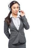 Slimme Aziatische Vrouw die met Hoofdtelefoon en Microfoon luisteren royalty-vrije stock foto