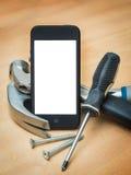 Slimme telefoon en bouwhulpmiddelen Stock Foto