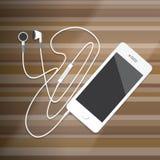 Slimme Telefoon met Oortelefoon op houten Desktop Royalty-vrije Stock Afbeelding
