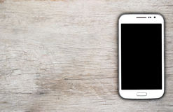 Slimme telefoon op houten achtergrond Royalty-vrije Stock Afbeeldingen