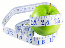 Slimming apple. Apple with measuring tape isolated on white Royalty Free Stock Photos